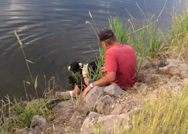 Milo Fisher and Puppy by a Lake