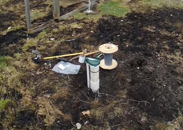 all-state well drilling well cap in a yard